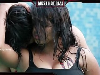 Indian couple kissing in a pool